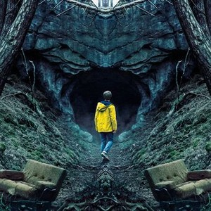 "Cover Image for the ""Dark"" series: a teen age boy wearing a yellow rain coat and jeans staring into the most of a dark and unlit cave in the woods"